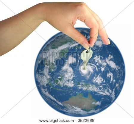 Woman Hand Giving The Key Of The World Isolated Over White