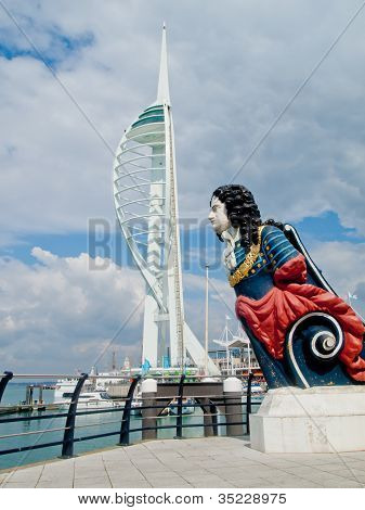 Editorial use Spinnaker Tower and a ships figurehead