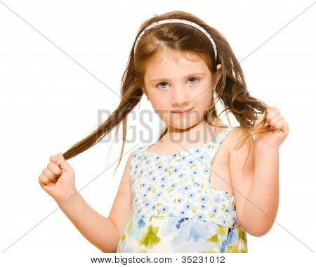 Hair care concept with portrait of young girl holding her long hair isolated on white