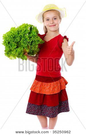 Smiling girl with lettuce salad
