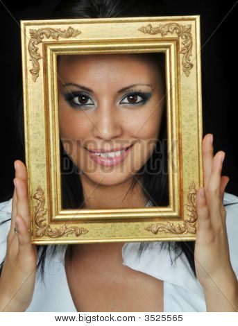 Beautiful Woman Holding A Gold Frame