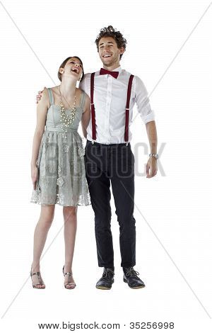 Teen Couple In Party Clothes Hug And Laugh.