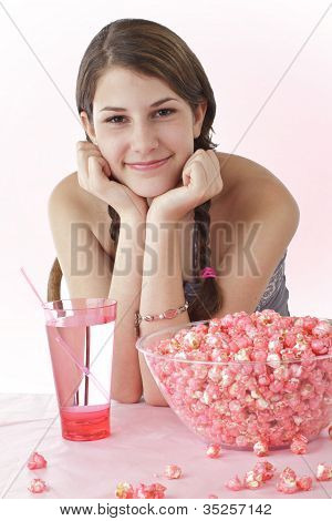 Smiling Teen Girl With Pink Popcorn And Drink