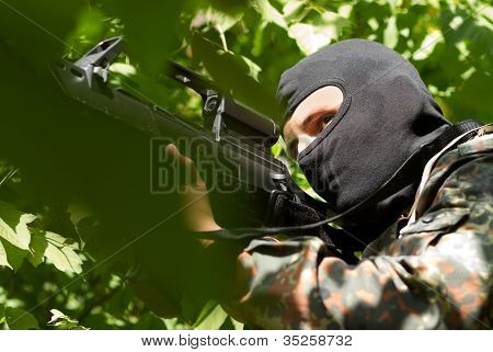 Terrorist In Black Mask With A Gun