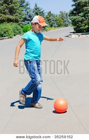 Little Boy Plays With A Ball