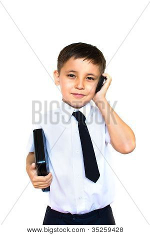 Boy Holding A Laptop And Talking On The Phone