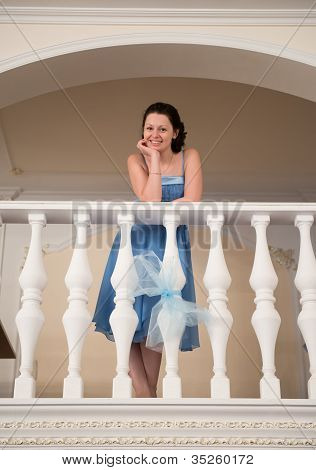 A Beautiful Woman In A Blue Dress