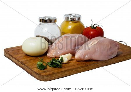 A Pair Of Skinless Chicken Breasts On A Cutting Board