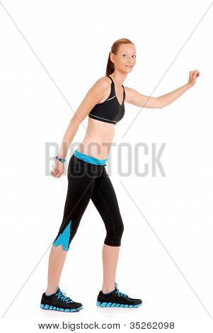 woman wearing black blue fitness outfit