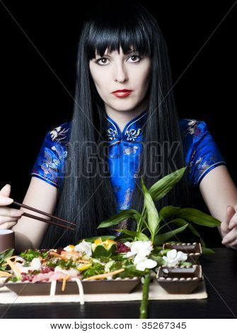 Black-haired Girl With A Chopsticks