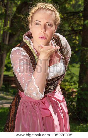Bavarian girl handing out kiss