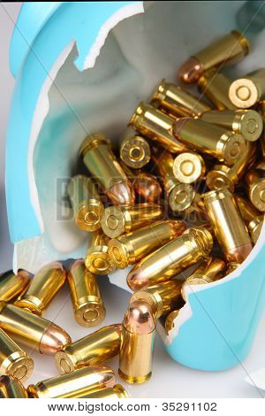 Brass Cartridges Spill from Cracked Piggybank