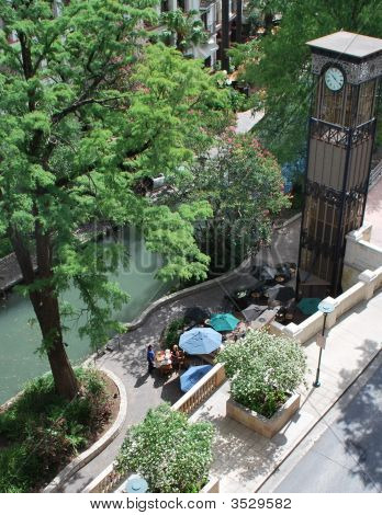 Tourist Couple Dine On Riverwalk Patio