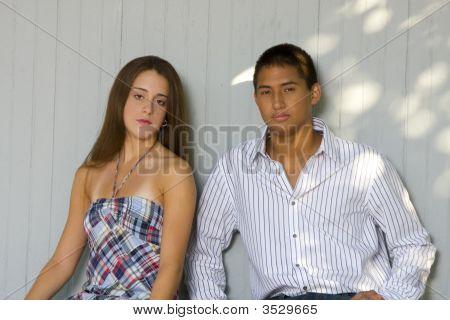 Teenage Couple Sitting Together