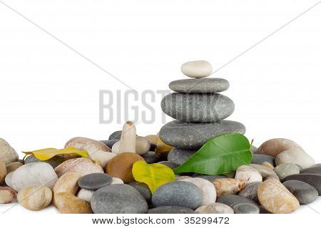 Pyramid Of The Round Sea Stones With Leaves
