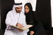 picture of tasbih  - Arabic Couple Looking Into The Holy Quran - JPG