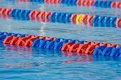 image of swim meet  - diagonal red an blue lines in sports swimming pool - JPG