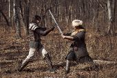 foto of average man  - Men in russian panoply fighting in forest - JPG