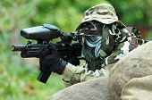 image of gun shot wound  - Picture of paintball shooter aiming to the enemy - JPG