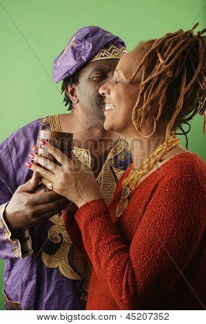 Portrait of happy couple kissing