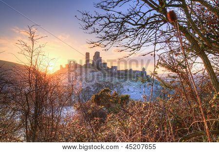 Winter sunrise over Corfe Castle with vibrant sky