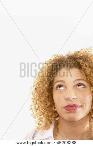 Close up of woman rolling eyes