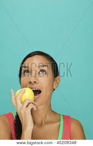Pretty woman eating apple
