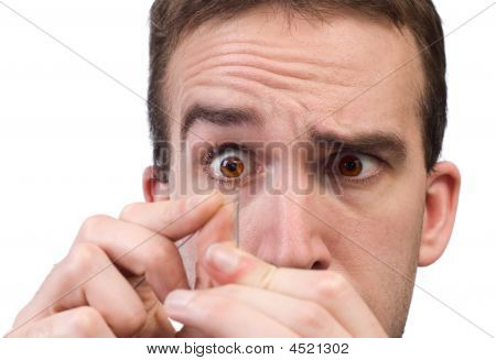 Man Threading A Needle