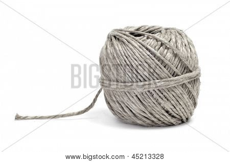 closeup of a coil of hemp twine on a white background