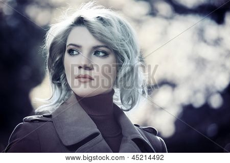 Young woman against a nature background