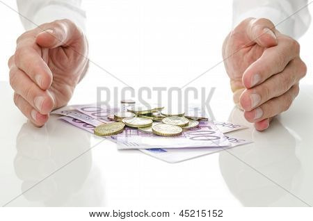 Hands Around Euro Coins And Banknotes