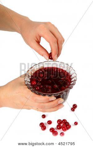 Bowl With Berry Jam In Female Hands