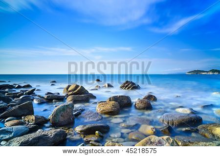 Baratti Bay, Rocks In A Blue Ocean On Sunset. Tuscany, Italy.