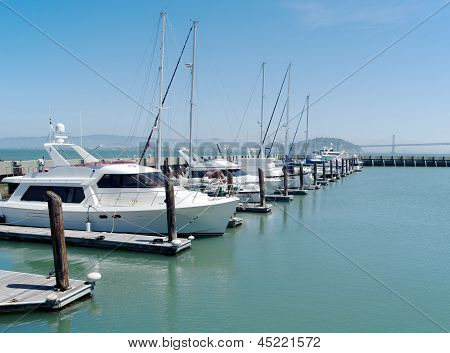 Single row of boats docked in San Francisco