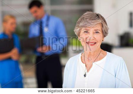 portrait of elderly woman in doctors office
