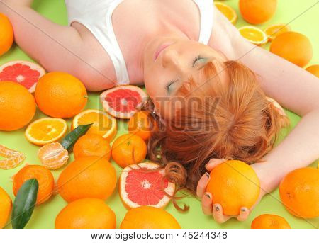 funny redhead girl with bright oranges