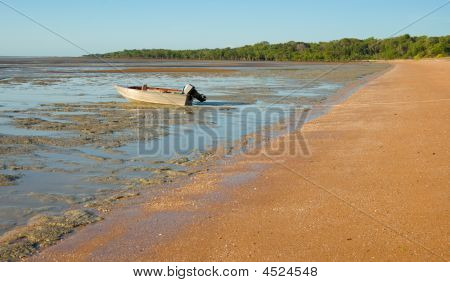 Boat On Coastal Mudflats
