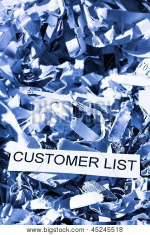 scraps of paper with the word customer list, photo icon for data destruction, data protection and customer data