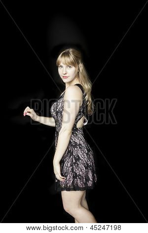 Young Woman With Beautiful Blue Eyes On Black Background