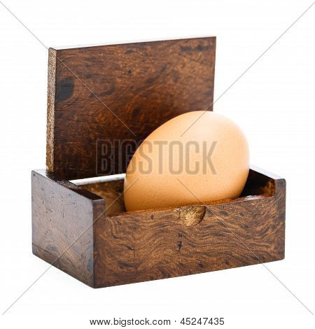 An Egg In The Wood Box