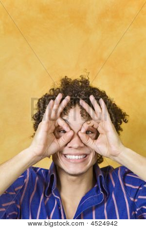 Man Smiling With Hand Over Eyes