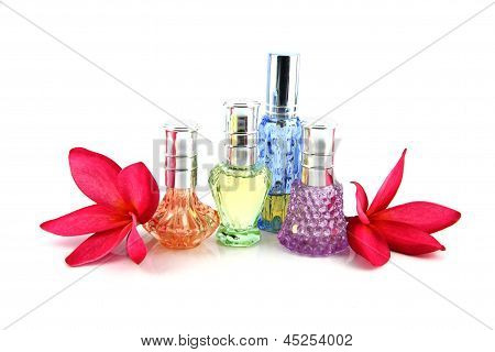 The Red Flowers And Perfume Bottles.