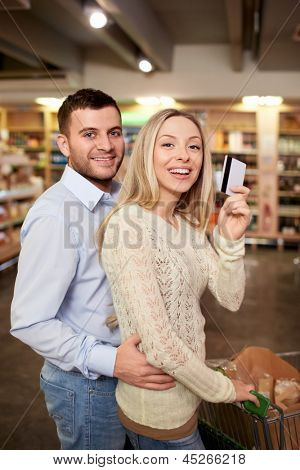 Young couple with a credit card