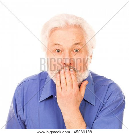 Elderly man holds hand on mouth isolated over white background