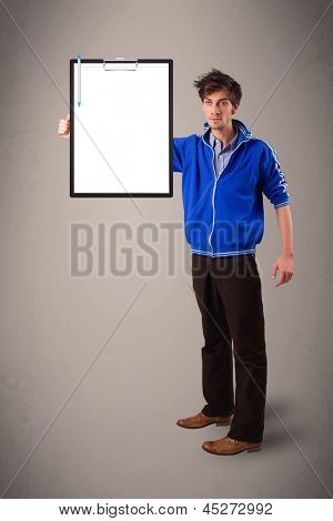 Handsome young boy holding black folder with white sheet copy space