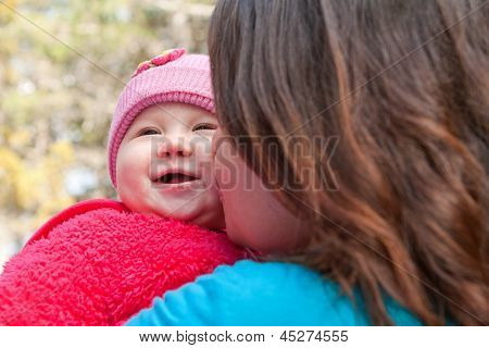 Mom Kissing Baby Daugther
