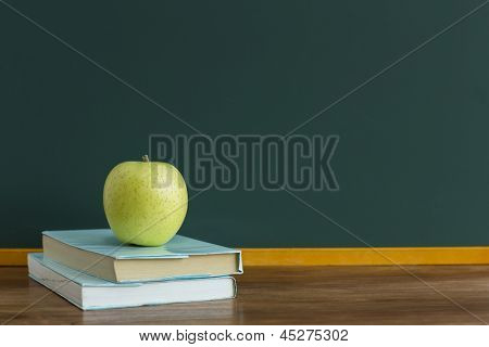 A blackboard and apple