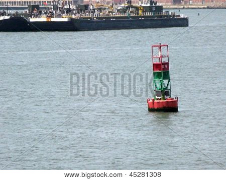 UPPER NEW YORK BAY - MAY 7: A buoy floats on May 7, 2013 in Upper New York Bay.