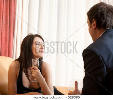 Young Happy Flirting Couple In Cafe
