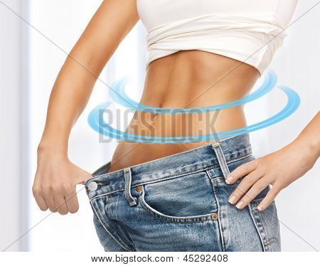 close up of woman showing big pants